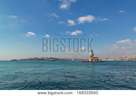 Maiden tower with eminonu area in istanbul far. poster