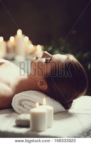 Massage. Beautiful girl in spa salon