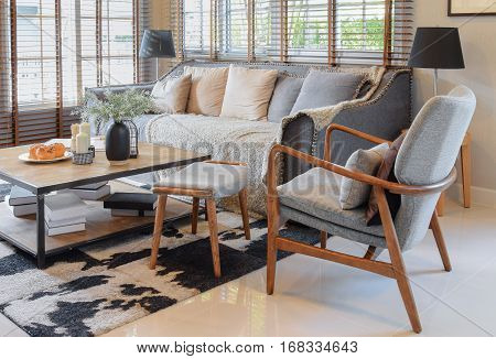 Living Room Interior With Pillows On Sofa And Decorative Wooden Table With Lamp