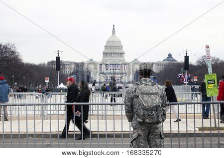 WASHINGTON DC - JANUARY 20: US soldier faces Capitol building during Inauguration of Donald Trump. Taken January 20 2017 in District of Columbia.