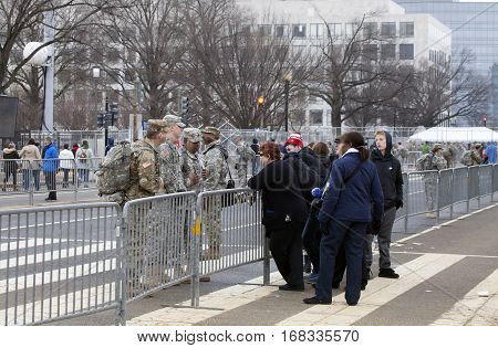 WASHINGTON DC - JANUARY 20: American soldiers assist civilians during inauguration of Donald Trump. Taken January 20 2017 in District of Columbia.