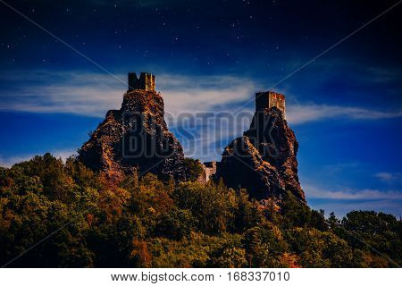 Two fairy castles on high mountains top at night