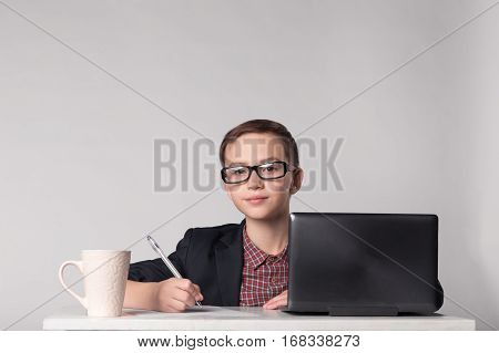 Business Kid In Suit And Glasses At The Work Place