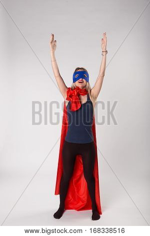 Superwoman In Superhero Costume Raised Hands Up