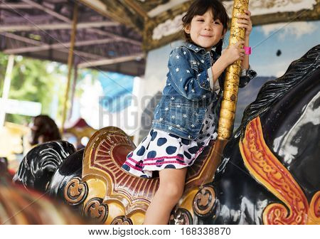 Little Girl Amusement Park Playful Merry Go Round
