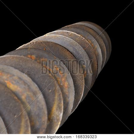 Array of old discarded sanding discs on a black background