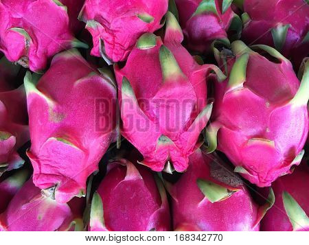 Dragon fruits background. Dragonfruits in the market.