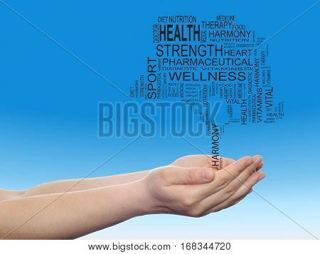 Concept conceptual black health text word cloud tagcloud as tree in man woman hand  on blue sky background metaphor to health, nutrition, diet, wellness, body, energy, medical, sport, heart or science