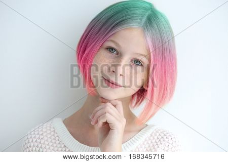 Trendy hairstyle concept. Girl with colorful dyed hair on white background poster