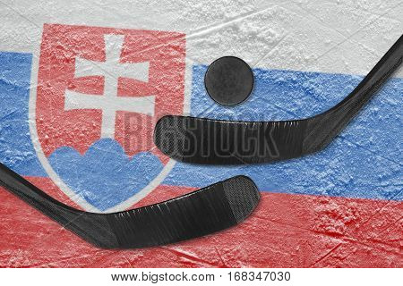 Hockey puck hockey sticks and image of the Slovak flag on the ice. Concept