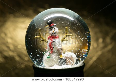 Winter Snow Globe With Snowman On Gold