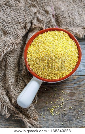 Raw Millet In A Ceramic Bowl.