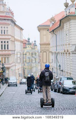 Prague, Czechia - December, 24, 2016: tourists on segways in Prague, Czechia