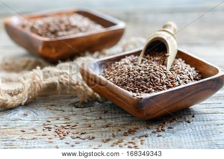 Flax Seeds In A Square Wooden Bowl.