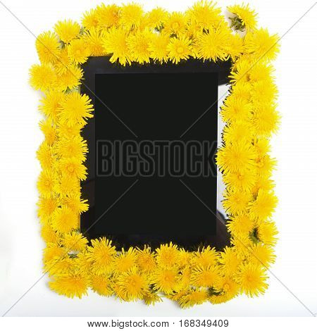 Tablet And Yellow Dandelion Flower On White Background.