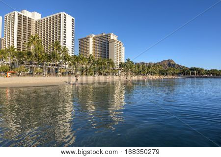 WAIKIKI OAHU USA - JANUARY 27 2017: Waikiki Beach has something for everyone with its modern infraestructure and first class ammenities to its beautiful calm beach and gorgeous sunsets and views.