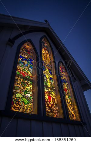 KERIKERI NZ - SEP 5: Stained Glass Windows of the St James Church at Night in Kerikeri New Zealand on Sep 5 2012