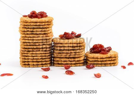 Stack of sweet crunchy biscuits on white.