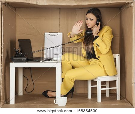 Business Woman Performs A Gesture Stop During A Telephone Conversation