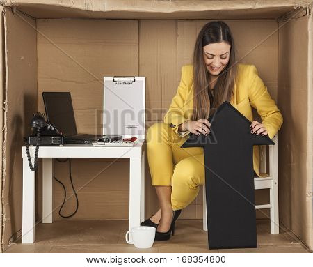 Business Woman Holds The Arrow Up Sign To Bounce Back From The Bottom