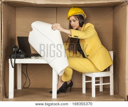 Young Business Woman Carefully Reading Building Plans