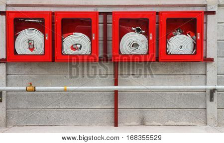 Fire extinguisher equipment on the wall (fire protection system)