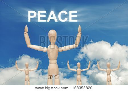 Wooden dummy puppet on sky background with word PEACE. Abstract conceptual image