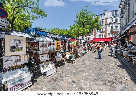 Paris, France - June 2016: Walking at Montmartre on a sunny day