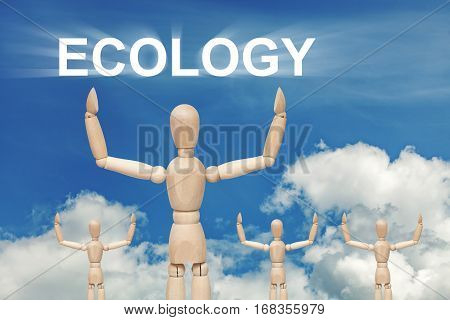Wooden dummy puppet on sky background with word ECOLOGY. Abstract conceptual image