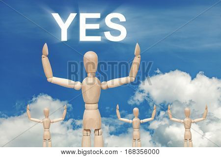 Wooden dummy puppet on sky background with word YES. Abstract conceptual image