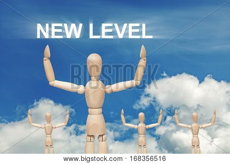 Wooden dummy puppet on sky background with words NEW LEVEL. Abstract conceptual image
