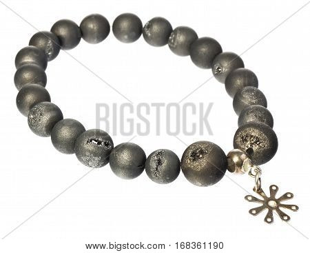 Necklace with coral beads and silver star. Jewellery in warm olive-gray color with light flashes. Corals isolated on a white background with slight shadow.