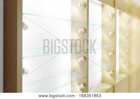 Blank wooden showcase design mockup side view 3d rendering. Clear white wood show case with empty glass shelves mock up. Store wall with modern furniture. Shop front view with bright rack template.