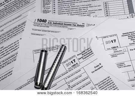 Filing annual tax forms 1040 with Internal Revenue Service.