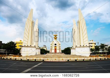 Bangkok, Thailand. Democracy monument in the center of Bangkok, Thailand. Popular touristic monument with cloudy sky