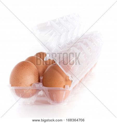 Dozen of the egg at the plastic tray. Shallow depth of field. Defocused blurry background.