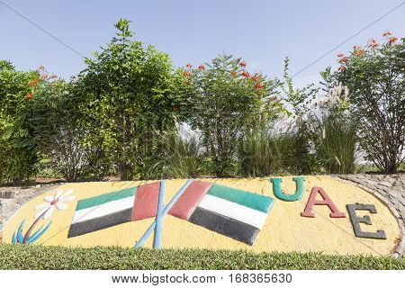 MEZAIRAA, UAE - DEC 4, 2016: UAE national flags monument in a roundabout in Liwa Oasis. Emirate of Abu Dhabi United Arab Emirates Middle East