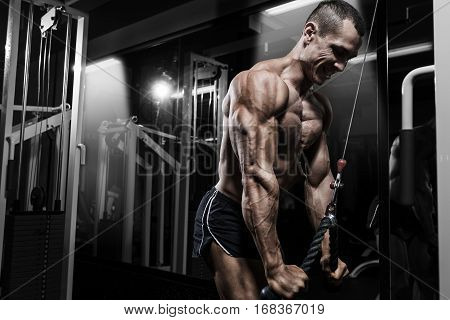 Athlete Muscular Bodybuilder Training Back On Simulator In The Gym