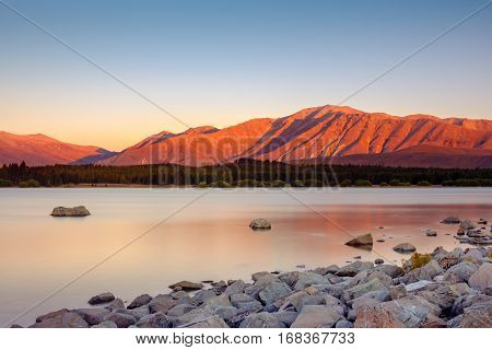 Long Exposure Landscape View Of Lake Tekapo And Mountains, Nz