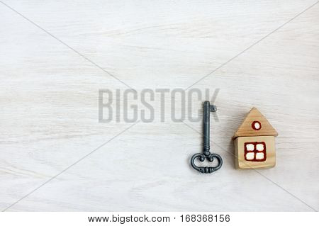 flat layout of a small wooden house with painted windows and a rare key / idea of individual property