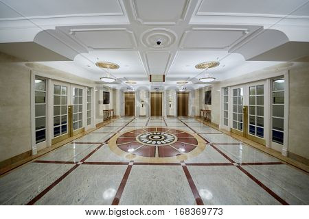 MOSCOW, RUSSIA - NOV 13, 2015: Empty hall at Radisson Royal Ukraine hotel. Radisson Royal Ukraine hotel is one of seven Stalin skyscrapers.