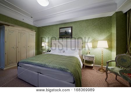 MOSCOW, RUSSIA - NOV 11, 2015: Interior of double room in hotel Radisson Royal Ukraine, one of the seven Stalin skyscrapers.