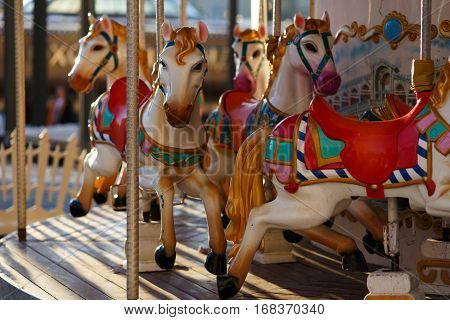 Photo of infant carousel with workhorses in afternoon