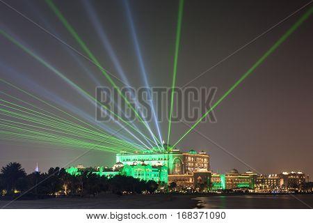 ABU DHABI UAE - DEC 3 2016: Emirates Palace in Abu Dhabi illuminated at night. United Arab Emirates Middle East