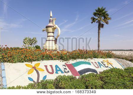 MEZAIRAA, UAE - DEC 4, 2016: Traditional arabian coffeepot monument in the desert town Mezairaa Emirate of Abu Dhabi United Arab Emirates