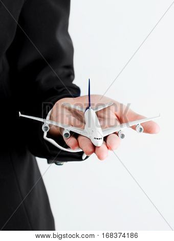 A plane model on a business woman's hand Isolated on white background.