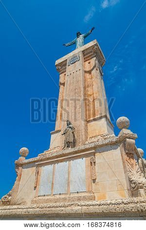 Statue of Jesus of the Sacred Heart monastery at Menorca Island highest point Monte Toro, Spain.