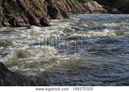 Rocks and whitewater rapids on the