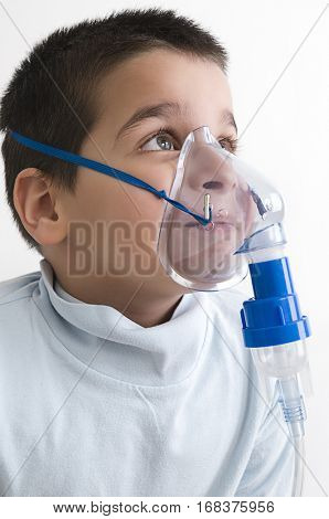 Portrait of cute child using asthma inhaler isolated on white background