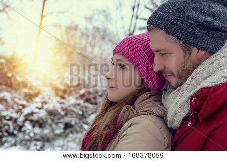 couple embracing  eachother in winter season